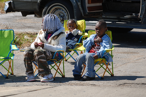 young family watches parade.jpg